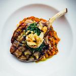 Pork cutlet, Basilicata sausage cassoulet, crackling, salsa verdi