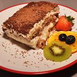 Traditional Tiramisu with drizzle fruit salad
