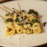 Paturi (chickpea flour pasta made with yogurt, flavoured with ginger, green chillies and served with a green sauce)
