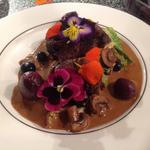Venison loin with wild mushroom and port sauce and edible flowers