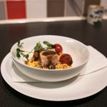 Risotto of chorizo and peas with roasted pork belly