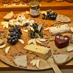 Selection of artisan British cheeses with condiments and crackers