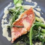 Pan fried red mullet with butter poached asparagus, sea vegetables and gin and lemon beuree blanc