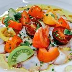 Octopus carpaccio with heritage tomatoes, my harrisa, chives & octopus dressing