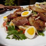 Salade de caille aux pommes de terre, œufs de caille, persil, fenouil et tomates cerises