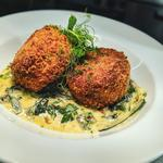 Catch of the day fish cakes, creamed leeks and local vegetables