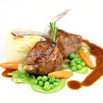 Roast rack of lamb with potatoes Dauphinoise and seasonal vegetables