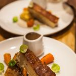 pork belly, pomme anna, thyme and honey glazed carrots, pine nut puree, sprout leaves and cider sauce photo by Tory McTernan