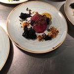 Pigeon breast from Blackmoor, game with red kale, dukkah spiced hazelnuts, curried carrot foam and drunk brambles