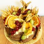 Cardamom Orange and Polenta Cake with orange flower water syrup and grapefruit cream adorned with fruits. Gluten Free!