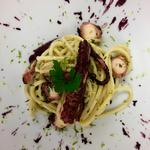Gragnano DOP Spaghetti with slow cooked octopus, red radicchio sauce and lime zest.