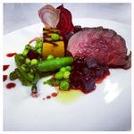 Roast Fillet of Beef with a Fondant Sweet Potato, Mint and Basil Pesto, Butter-Glazed Garden Peas, Beetroot Crisps and a Beef and Beetroot Cumberland Sauce