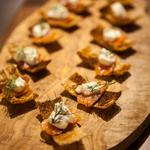 melba toast topped with citrus cured salmon creme fraiche and dil, photo by Tory McTernan