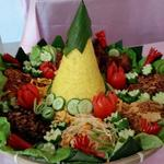 Yellow coconut rice with 6 side dishes including curry, salad,vegetables, this is a typical party dishes for occasion in Indonesia.