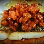 Bass fillet with chorizo salsa and borlotti beans in a smoked tomato sauce