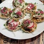 Chicken in pumpkin seeds with black bean sopes (small corn tarts)