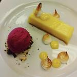 Lemon tart, vanilla mayonnaise, Italian meringue, chocolate soil, raspberry sorbet