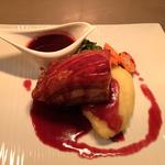 Slow cooked pork belly with red fruit sauce