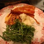 Monkfish tails, cripsy bacon, rocket salad, creamed potatoes