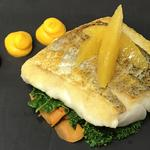 Roast hake with cake textures and kale, orange segments