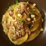 Pasta Corzetti, braised rabbit, leeks, local hazelnuts