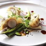 Pork and leek dumplings with grilled baby leek, edamame beans and yuzu sauce
