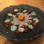 Scallops, Hamachi, Salmon Carpaccio with Kizami wasabi and ova flavoured dressing.