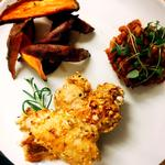 popcorn coated chicken with sweet potato wedges and beans