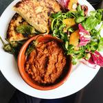 Spanish tapas - Romesco sauce, tortilla de patatas, padron peppers, citrusy salad