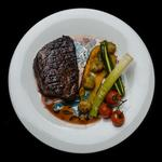 Cocoa rubbed fillet of beef with roasted rosemary and sea salt potato, seasonal vegetables and a merlot and chcolate jus