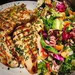 Grilled free range chicken breast with fresh rosemary and mixed salad