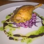 Duck leg confit on red slaw