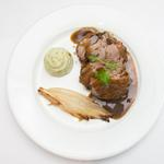 Lamb rump, basil mash, caramelised vanilla chicory and ratatouille served with a Madeira Jus