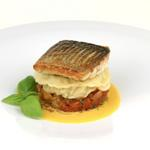 Pan fried fillet of wild seabass, prawn raviolo, saffron veloute