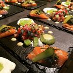 Salmon Ceviche, Salsa Verde, Horseradish cream, Wasabi Cucumber and Roasted Lemon Puree