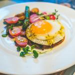 Duck egg tart with radishes and champagne butter