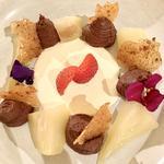 Chocolate cremeaux, hazelnut brittle, poached pear & cream