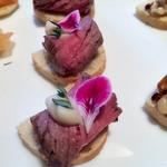 Rare roast beef and horseradish canape, rosemary and edible flowers