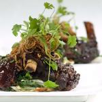 Sticky Iberico pork ribs, kale and peanut slaw